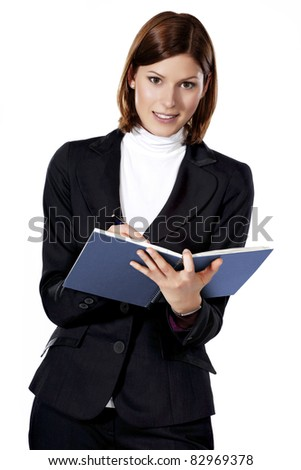 Detail of a beautiful young businesswoman writing in a notebook - stock photo