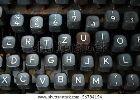 detail of a black vintage typewriter close up on keys - stock photo