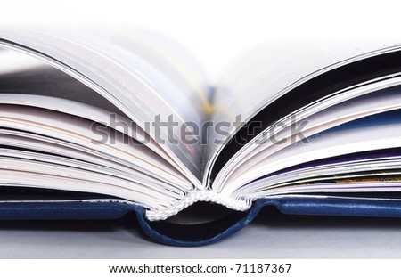 detail of a blue open book isolated on white background - stock photo