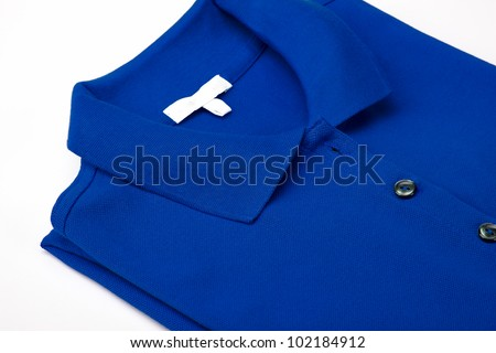 Detail of a blue polo shirt. - stock photo