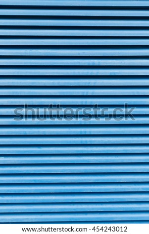 detail of a blue window with shutters  - stock photo