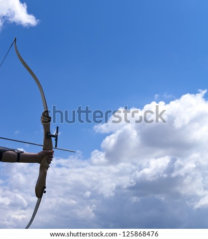 Detail of a bow and arrow. - stock photo