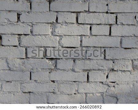 Detail of a brick wall painted in white useful as a background - stock photo