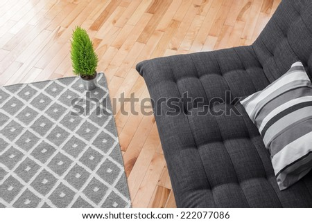 Detail of a bright modern living room with simple decor. - stock photo