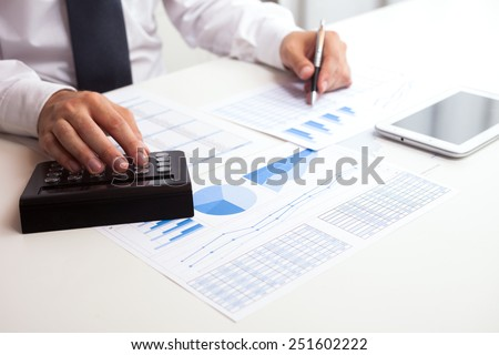 Detail of a business man at work in his office - stock photo