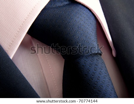 Detail of a business man suit, shirt and tie - stock photo