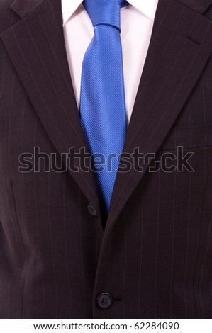Detail of a Business man Suit with blue tie