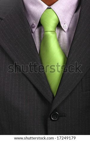 detail of a Business man Suit with green tie - stock photo