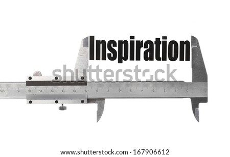 """Detail of a caliper measuring the word """"Inspiration"""". - stock photo"""