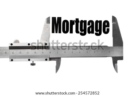 """Detail of a caliper measuring the word """"Mortgage"""". - stock photo"""