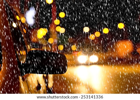 detail of a car in the snowstorm - stock photo