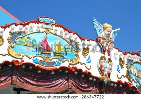 Detail of a carousel with cupids, close-up - stock photo