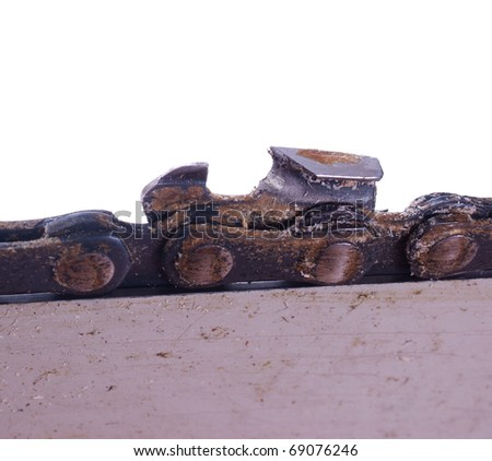 detail of a  chainsaw tooth, isolated on background - stock photo