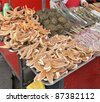 detail of a chinese market stall with lots of strange food in Beijing (China) - stock photo