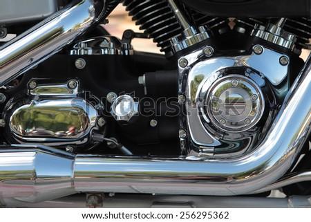 detail of a chrome motorbike engine - stock photo