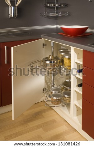 detail of a circular open kitchen cabinet with cans of beans - stock photo