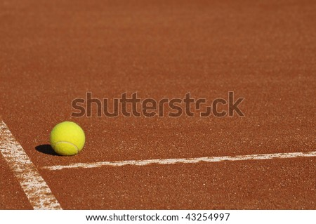 Detail of a clay court with tennis ball - stock photo