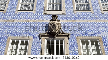 Detail of a coat of arms placed above the central window on the decorative facade of a main building in Braga, Portugal  - stock photo