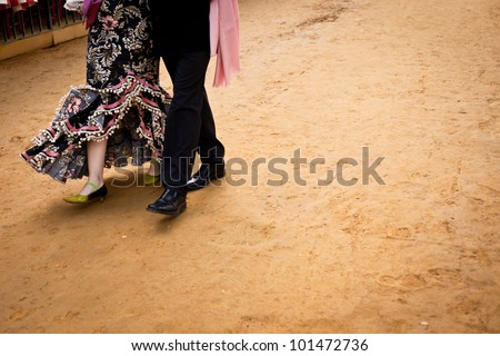 Detail of a couple wearing flamenco outfits in Seville, Spain. - stock photo