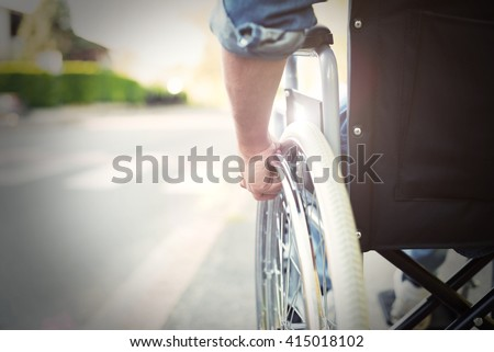 Detail of a disabled man on a wheelchair - stock photo