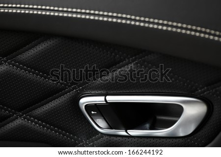 Detail of a door opener from inside of a car - stock photo