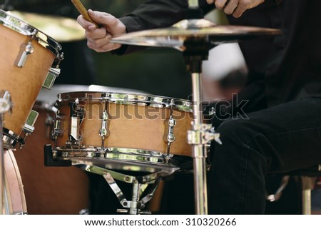 detail of a drummer on the rock concert, selective focus  - stock photo