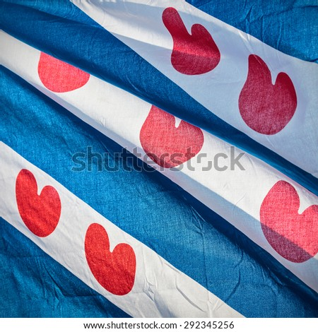 Detail of a Dutch Frisian waving province flag - stock photo