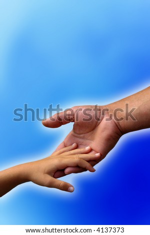 detail of a father hand holding his child hand over blue background