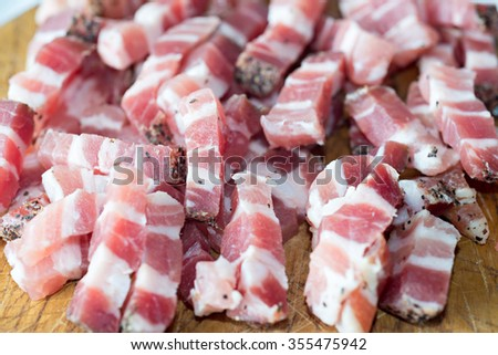 Detail of a few pieces of raw bacon - stock photo