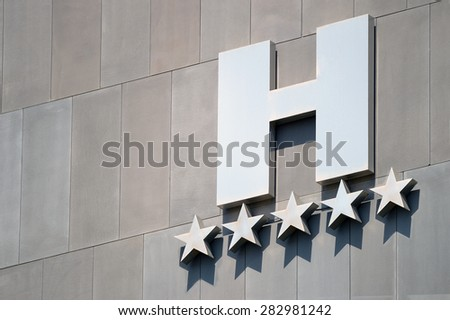 Detail of a five stars hotel facade - stock photo