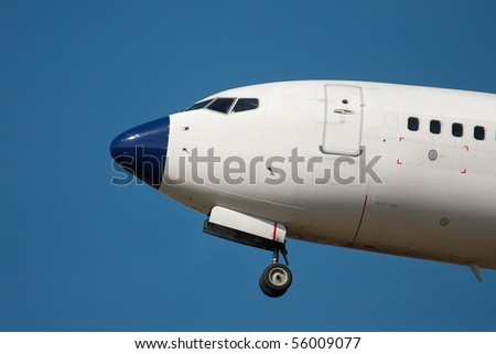 Detail of a flying airplane - stock photo