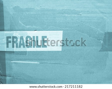 Detail of a fragile corrugated cardboard packet - cool cyanotype - stock photo