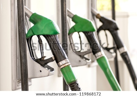 Detail of a fuel pump in a gas station - stock photo