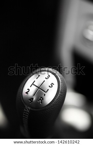 Detail of a gear stick inside of a car - stock photo