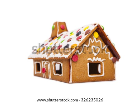 Detail of a gingerbread house decorated with sweets and icing.  - stock photo