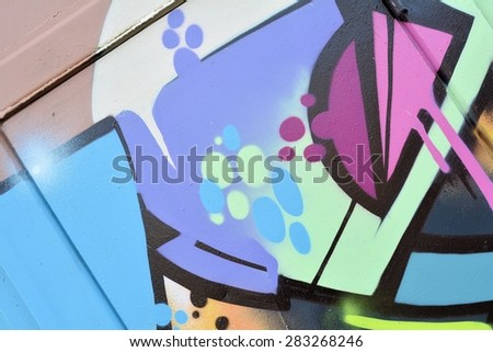 Detail of a graffiti on a wall - stock photo