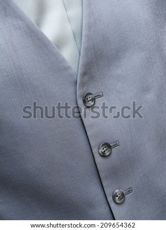 Detail of a grey vest an tie - groom in wedding day - stock photo