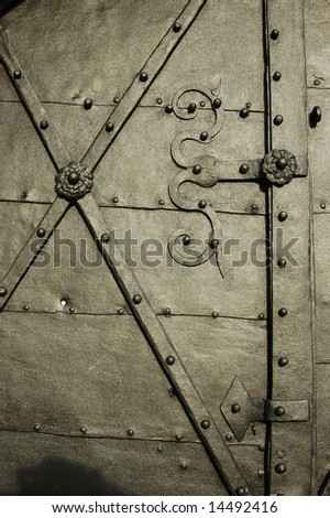 Detail of a heavy metal reinforced door