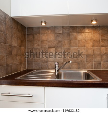 detail of a kitchen sink - stock photo
