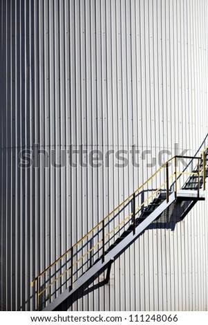Detail of a ladder going up a big reservoir - stock photo
