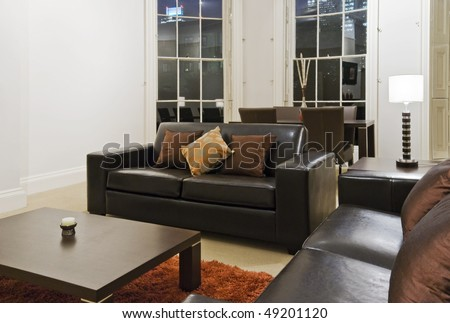 detail of a living room with massive bay window and modern furniture - stock photo
