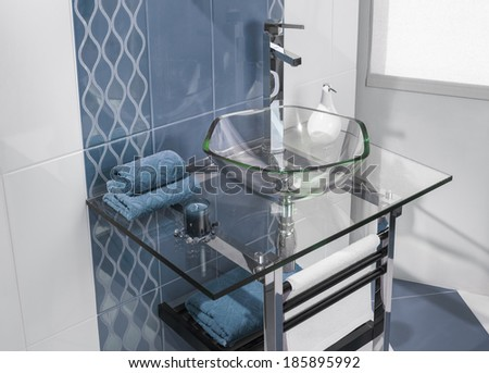 detail of a luxurious bathroom with blue tiles and sink of glass - stock photo