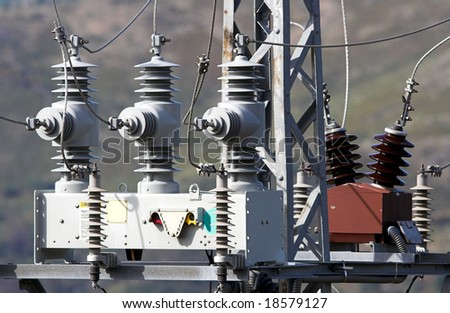 Detail of a medium voltage power pylon in a mountain - stock photo