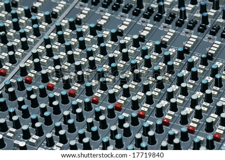 Detail of a mixing board in a recording studio - This is shot in a real studio  - some dust visible