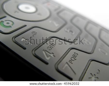 Detail of a mobile phone with a shallow depth of field - stock photo
