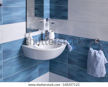 detail of a modern bathroom with sink and accessories - stock photo