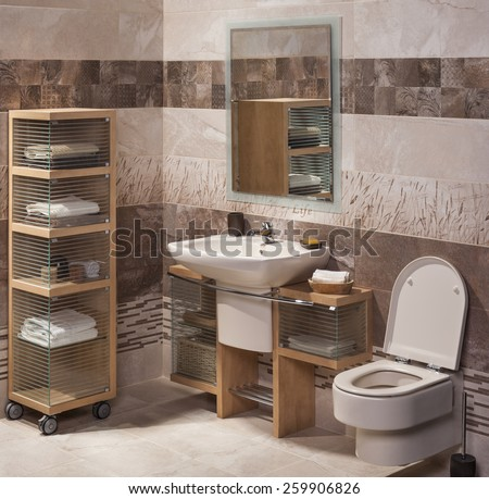 detail of a modern bathroom with sink, cabinet for towels and toilet - stock photo