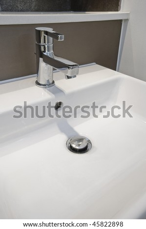 detail of a modern designer hand wash basin - stock photo