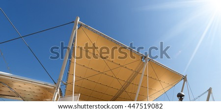 Detail Of A Modern Tensile Structure, Membrane Fabric Roof With Poles And  Steel Cables,