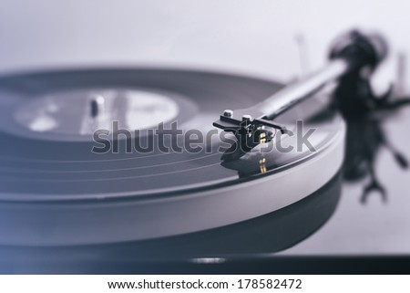 Detail of a modern vinyl record player (turntable) with a vintage image look. - stock photo